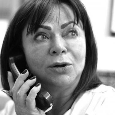 picture of Stella, the office manage, on the phone
