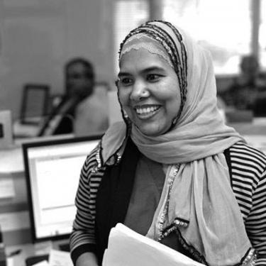 Photo of woman wearing head scarf