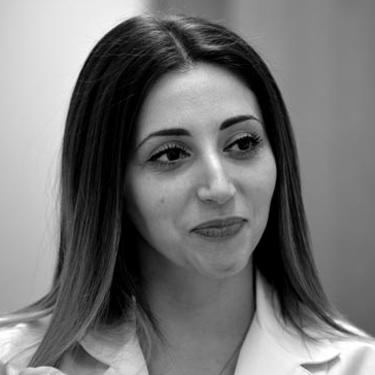photo of young, attractive assistant smiling in Dr Erber's office