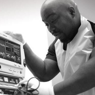 lab technician working at lab equipmentin Brooklyn Gastroenterologists' office
