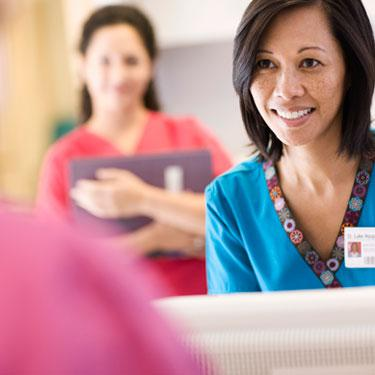 woman checking in patient in doctors office