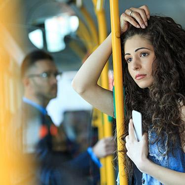 Woman on subway with fatty liver disease going to gastroenterologist