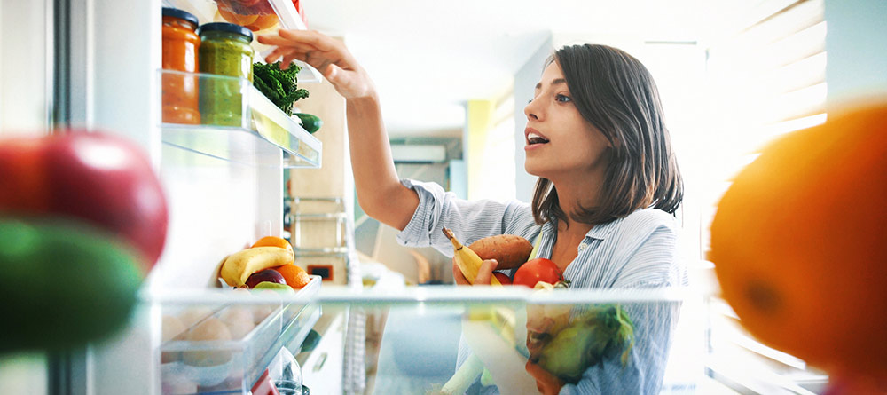 woman eating healthy in her home